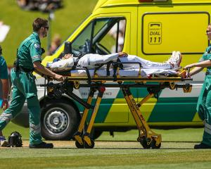 Mushfiqur Rahim is stretchered into an ambulance after being struck in the helmet by a delivery...