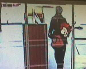 Police are looking for a gunman who robbed a Kiwibank in Christchurch. Photo: via Christchurch...