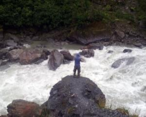 Collin Kolmer of Frankfurt above Haast River at Gates of Haast on the West Coast about 7pm. Photo...