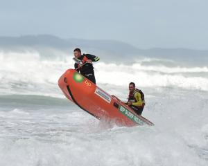 A Brighton Surf Lifesaving Club IRB battles rough seas during the search on Friday. Photo Gregor...