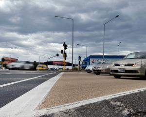 Motorists take part in a trial of a new calcined bauxite skid-resistant road surface at the...