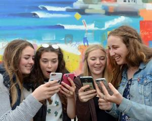 Checking their NCEA results online yesterday are (from left) Bayfield High School pupils Georgia...
