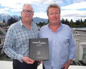 Russell Gray (left) and Al Spary with their Botswana Butchery cookbook. Photo from Mountain Scene.