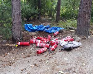 Fire extinguishers used to fight a forest fire near Queenstown's Matakauri Lodge on Saturday....
