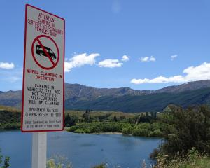 A new sign at the entrance to the northern end of Lake Hayes warns against anyone freedom camping...