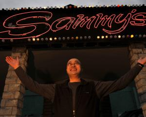 Sam Chin outside Sammy's when it reopened in mid-2011. Photo by Gerard O'Brien.