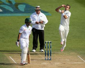 Tim Southee bowls late on day four in Bangladesh's second innings against New Zealand. Photo:...