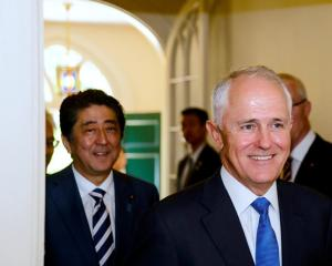 Japanese PM Shinzo Abe and Australian PM Malcolm Turnbull spoke of their desire to see the TPP...