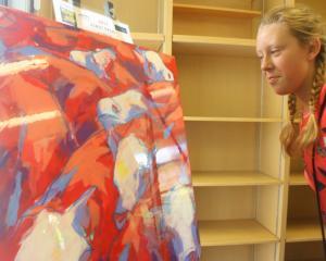 Maysn Harrex (12), of Dunedin, takes a closer look at the Amelia Guild's Aspiring Art prize...
