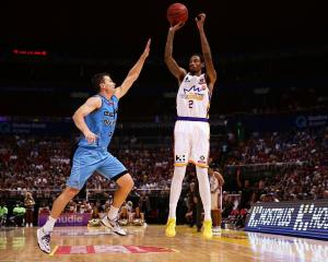 Greg Whittington shoots over Kirk Penney during the Breakers' loss to the Sydney Kings. Photo:...