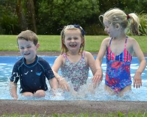 Making the most of a brief spell of warm weather, friends William Hepburn (3), Indy Matchett (6)...