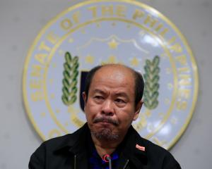 Arturo Lascanas, a retired Davao policeman, speaks during a news conference at the Senate...