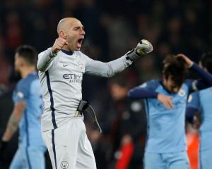 Manchester City's Willy Caballero celebrates after the game. Photo Reuters