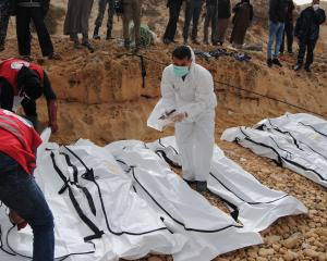 Bodies of migrants were also washed up on a beach near the city of Zawiya, Libya. Photo: Reuters