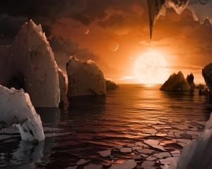An artist's depiction shows the possible surface of TRAPPIST-1f, on one of seven newly discovered...