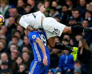 Swansea City's Kyle Naughton (top) in action with Chelsea's Diego Costa. Photo: Reuters