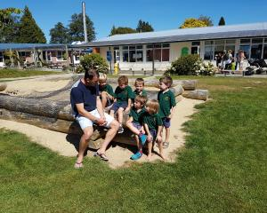 Te Anau Primary School principal Grant Excell with some of the growing number of pupils (from...