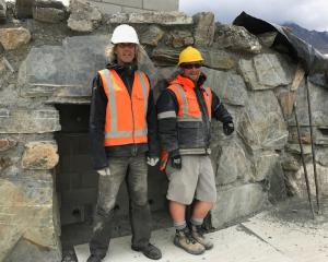 Artist Dan Kelly (left) and John Golden take a break from work on Camp Glenorchy's Scheelite...