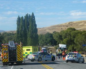 Emergency services attend the scene of a fatal crash near Alexandra yesterday. Photo by Pam Jones.