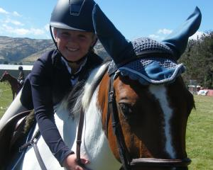 Jess Hore (9), of Beaumont Station, shares a moment with her crossbred pony Beau at the...