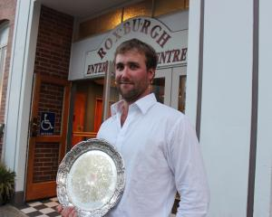 Nigel Woodhead, of Milton,  displays the Young Farmer  Otago-Southland regional final plate he...