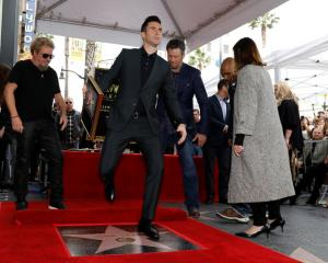 Musician Levine steps on his star after it was unveiled on the Hollywood Walk of Fame. Photo:...
