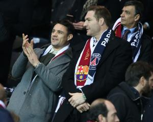 Former All Blacks Dan Carter and Ali Williams watch a football game in France. Photo: Getty Images
