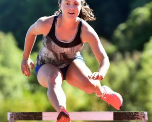 Christina Ashton  trains for the hurdles  for the Otago Championships this weekend at the...