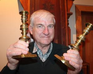 Prof Brian Roberts holds a set of candlestick holders which his ancestors salvaged from the wreck...