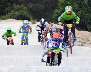 Lachie James, of Alexandra, leads the pack in the 12-13 boys race on the Dunedin BMX club's new...