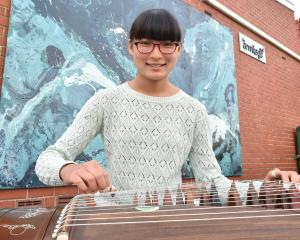 Sophie Sun plays the Chinese zither at the South Dunedin Busking Festival. Photo: Gregor Richardson.