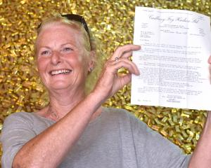 Marilyn Bethell (62) at the Cadbury factory in Dunedin, with her 1969 letter inviting her to tour...