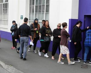Staff arrive for a meeting at Cadbury's in Dunedin yesterday. Photo ODT