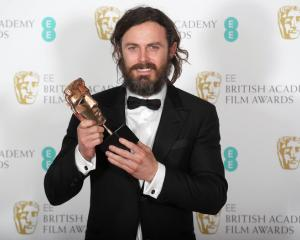 "Casey Affleck holds the award for best Leading Actor for ""Manchester by the Sea"" at the Baftas...."