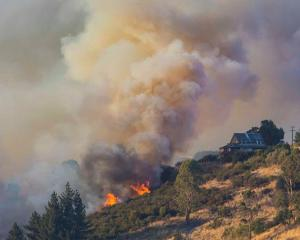 Fire crews have been battling the Port Hills blaze for nearly a week. Photo: Christchurch City...
