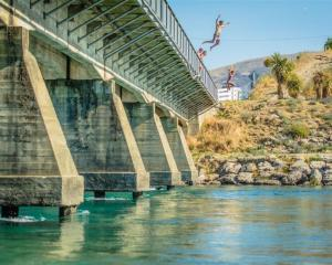 Jumping into the Clutha River. Photo: Si Williams