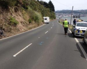 Police at the scene after tourist Wei Zhang's campervan clipped the bicycle being ridden by...