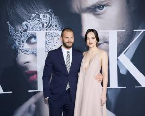 Jamie Dornan (Christian Grey) and Dakota Johnson (Ana Steele) at the premiere of the film 'Fifty...
