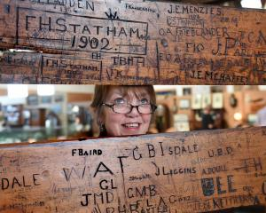 Lyn McCarthy, of Hayward's Auction House, with sections of old University of Otago lecture...