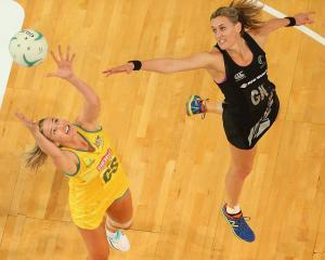 Leana de Bruin (right) competes with Caitlin Bassett for the ball during a Silver Ferns v...