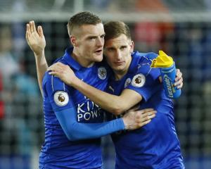 Leicester City's Jamie Vardy (left) celebrates after the game with Marc Albrighton. Photo: Reuters