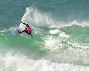 New Zealand surfing champion Maz Quinn, of Gisborne, surfs Aramoana during winter 2013, one of...