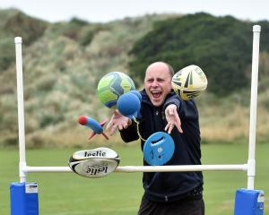 Sport Otago business development and events manager Michael Smith with some of the sporting gear...