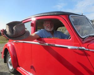 Brian Hosking, of Auckland, sits behind the wheel of his lovingly restored Riley  at this year's...