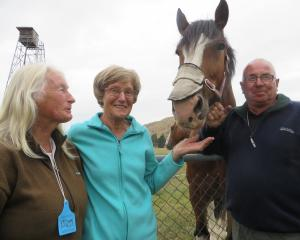 Brenda Harland (left), of Dunedin, and  Alice Sinclair and Les Bayne, of Mosgiel, meet  Flynn ...
