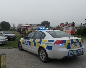 Fog and the lights of emergency service vehicles filled Waitaki Waters Holiday Park after police...