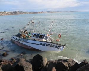 The swamped Jane Marie off Holmes Wharf, Oamaru. PHOTO: SHANNON GILLIES