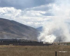 A helicopter is used to fight a grass fire at Otematata Station in the Upper Waitaki yesterday....
