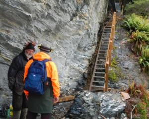 Inspecting new stairways on a section of track in the Rees Valley are contractor John Henderson ...