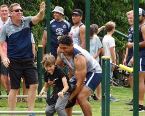 Cowboys lock and 2016 joint Dally M Medal winner Jason Taumalolo helps Arrowtown School pupil...